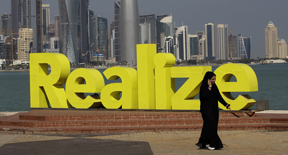 A women walks at the corniche seaside, in Doha, Qatar, on Sunday Jan. 23, 2011.