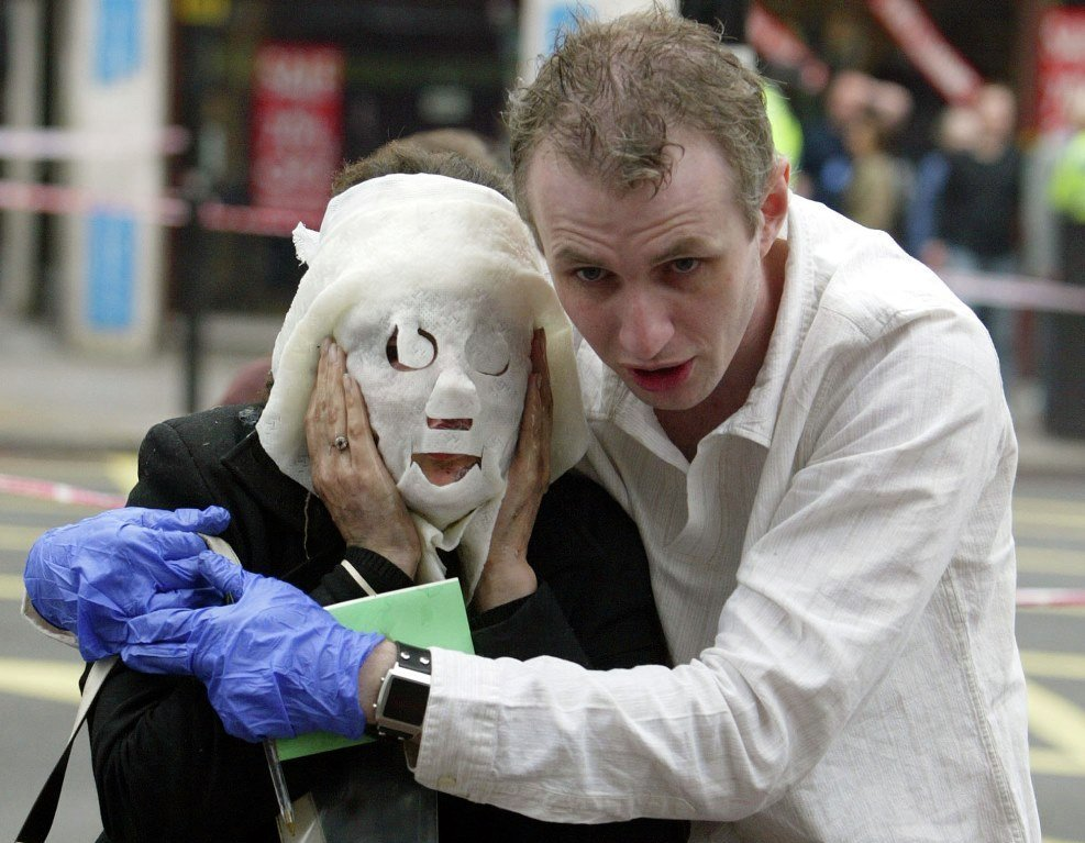 A July 7, 2005, file photo of Paul Dadge, right, as helps injured tube passenger Davinia Turrell away from Edgware Road tube station in London following an explosion.