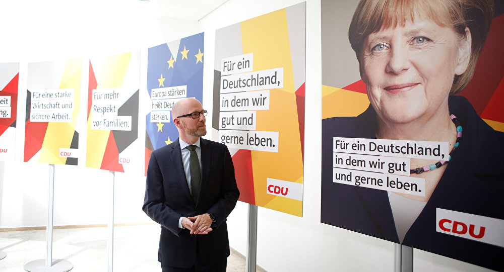 Peter Tauber, secretary general of the Christian Democratic Union party, CDU presents campaign posters for the upcoming general elections in Germany in Berlin, June 22, 2017