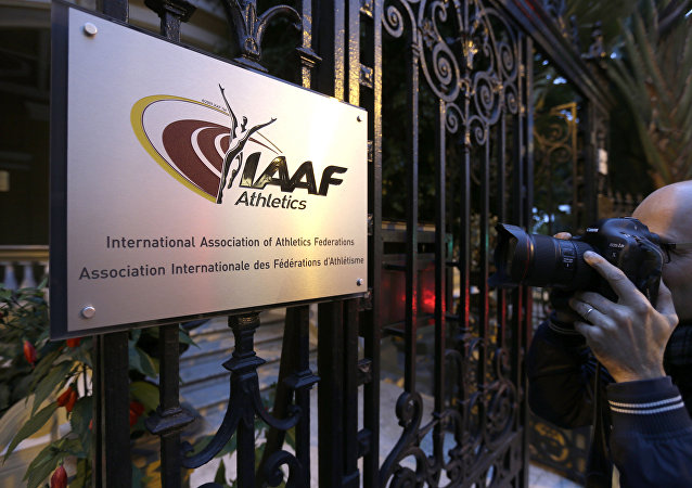 A photographer pictures the logo at the IAAF (International Amateur Athletic Federation) (File)