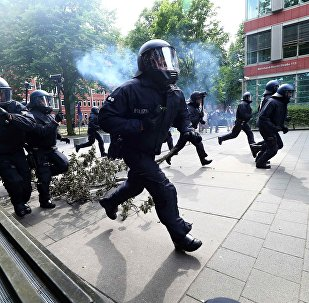 German police charge towards protesters during a demonstration at the G20 summit in Hamburg, Germany, July 7, 2017