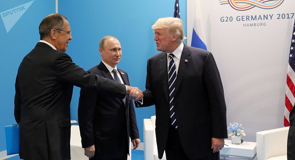 Russian President Vladimir Putin and President of the USA Donald Trump, right, talk during their meeting on the sidelines of the G20 summit in Hamburg. Left: Russian Foreign Minister Sergei Lavrov.