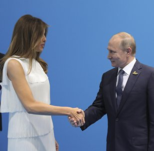 Russian President Vladimir Putin (R) shakes hands with U.S. First Lady Melania Trump during a meeting on the sidelines of the G20 summit in Hamburg, Germany July 7, 2017