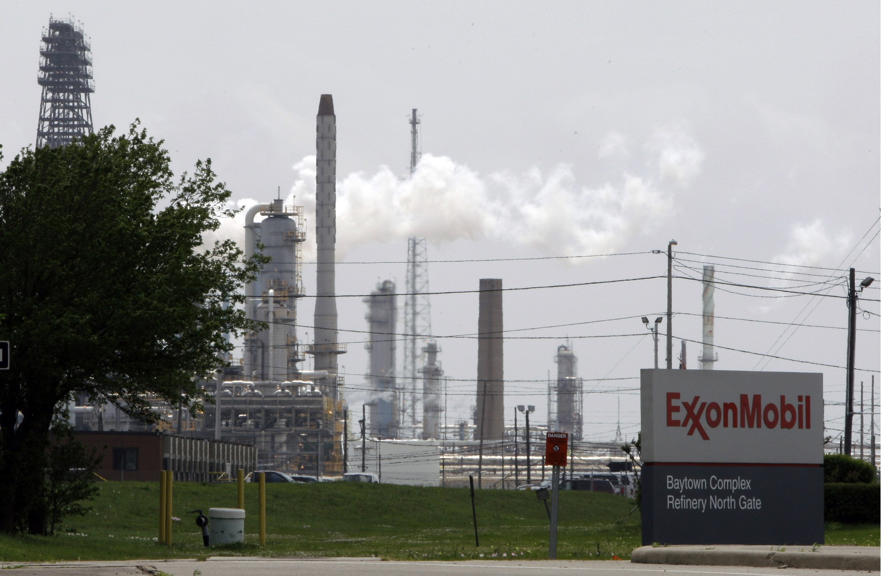 In this April 16, 2010 file photo, steam rises from towers at an Exxon Mobil refinery in Baytown, Texas