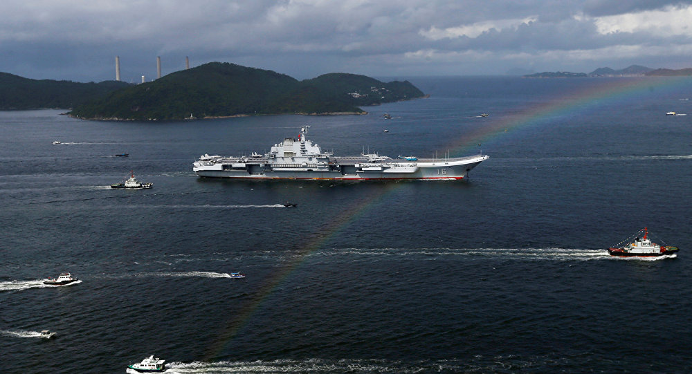 China's aircraft carrier Liaoning sails past a rainbow as it enters Hong Kong, China, July 7, 2017