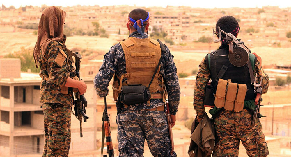 Syrian Democratic Forces (SDF), shows fighters from the SDF looking toward the northern town of Tabqa, Syria (File)