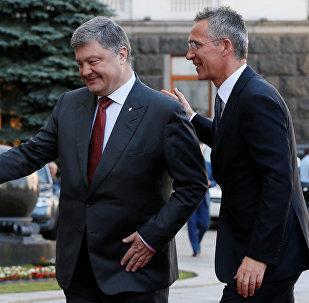Ukrainian President Petro Poroshenko and NATO Secretary General Jens Stoltenberg walk before a meeting in Kiev, Ukraine, July 10, 2017.