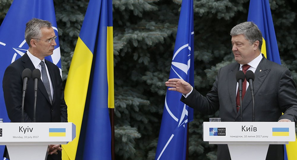 NATO Secretary General Jens Stoltenberg and Ukrainian President Petro Poroshenko attend a joint news conference following a meeting of the NATO-Ukraine Commission in Kiev, Ukraine, July 10, 2017.
