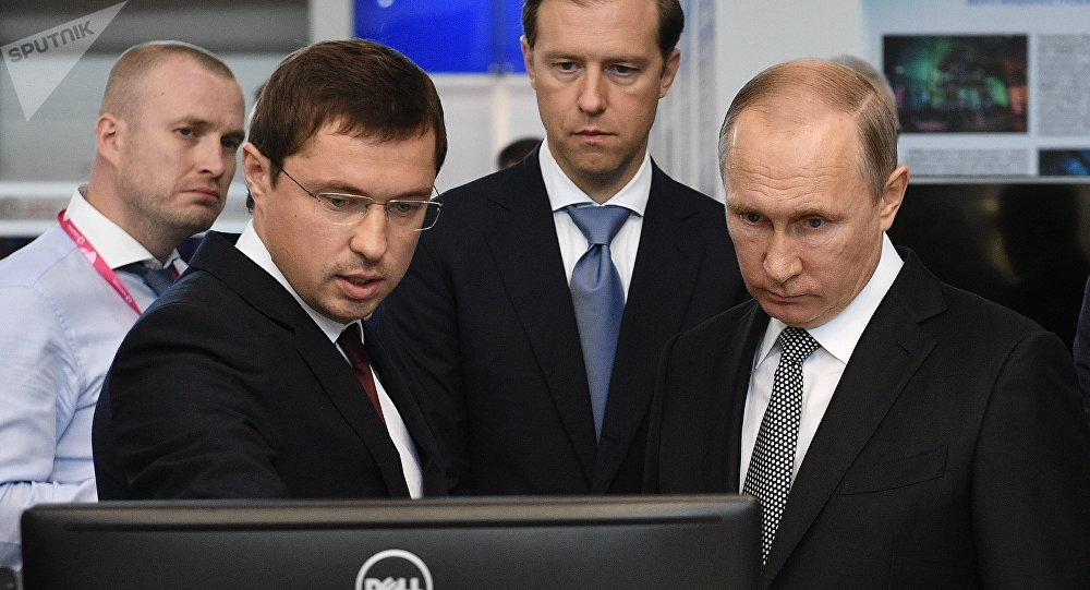 July 10, 2017. Russian President Vladimir Putin looks at Rostec Corporation's display during the 8th Innoprom International Industrial Trade Fair at the Yekaterinburg Expo International Exhibition Center. From left: Rostec Director for Special Commissions Vasily Brovko with Russian Minister of Industry and Trade Denis Manturov.