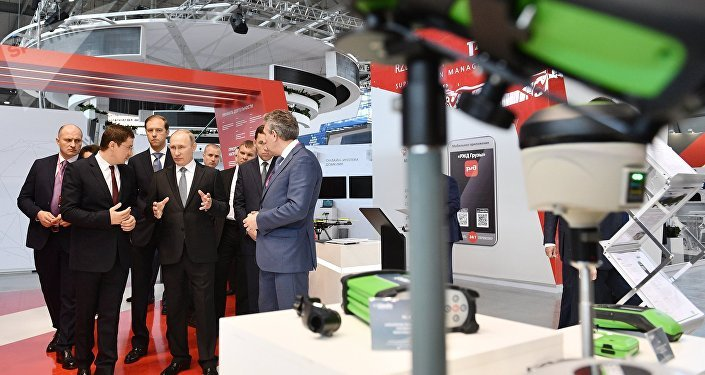 July 10, 2017. Russian President Vladimir Putin looks at Rostec Corporation's display during the 8th Innoprom International Industrial Trade Fair at the Yekaterinburg Expo International Exhibition Center.