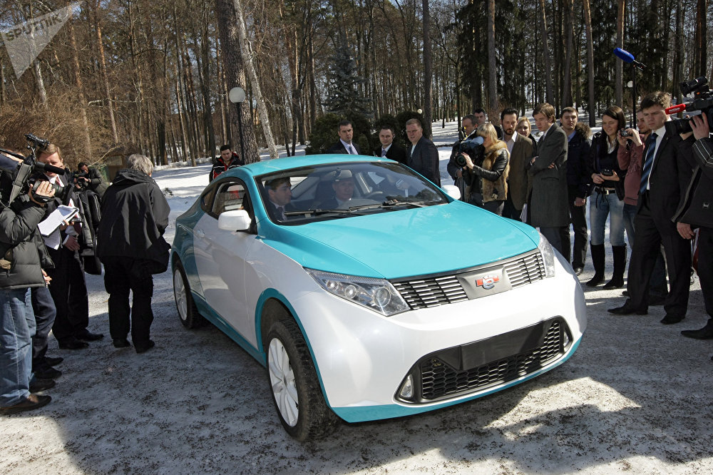 Prime Minister Vladimir Putin at the wheel of the new Yo-Mobile Cross Coupe