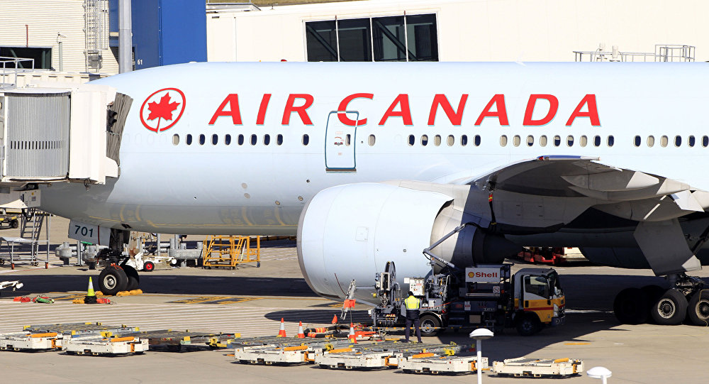 An Air Canada Boeing 777 sits at a gate after it was forced to return to Sydney Airport in Sydney, Thursday, July 28, 2011, after crew members saw smoke coming from an oven in the galley. No one on Flight AC34 was injured in the incident, which forced the pilot to dump fuel before safely landing.