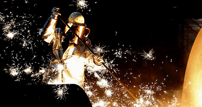 A worker at a blast furnace at Europe's largest steel factory of Germany's industrial conglomerate ThyssenKrupp AG in Duisburg, Germany December 6, 2012.