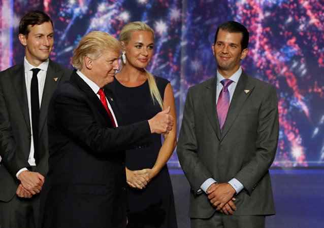 Donald Trump Jr. (R) watches along with his brother in law Jared Kushner (L) and Trump Jr's wife Vanessa (C) as his father Donald Trump (2nd L) celebrates after accepting the Republican presidential nomination at the 2016 Republican National Convention in Cleveland, Ohio U.S. July 21, 2016.