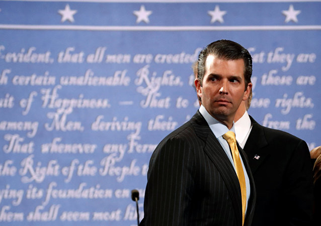 Donald Trump Jr. stands onstage with his father Republican U.S. presidential nominee Donald Trump after Trump's debate against Democratic nominee Hillary Clinton at Hofstra University in Hempstead, New York, U.S. September 26, 2016.