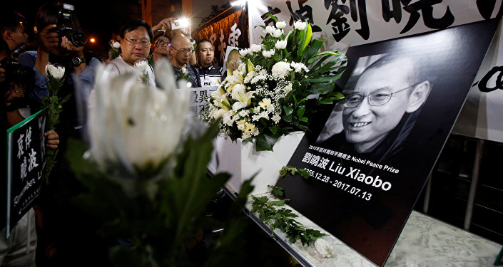 Pro-democracy activists mourn the death of Chinese Nobel Peace laureate Liu Xiaobo, outside China's Liaison Office in Hong Kong, China July 13, 2017.