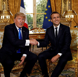 French President Emmanuel Macron and U.S. President Donald Trump (L) shake hands as they meet at the Elysee Palace in Paris, France, July 13, 2017.