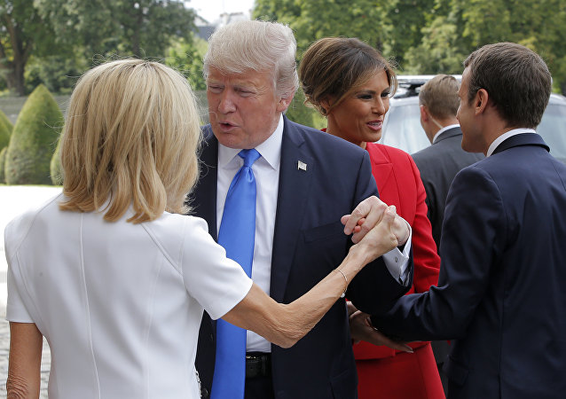 French President Emmanuel Macron, right, welcome First Lady Melania Trump while and his wife Brigitte, left, welcomes U.S President Donald Trump at Les Invalides museum in Paris Thursday, July 13, 2017.