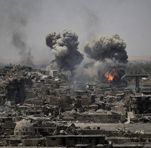 Airstrikes target Islamic State positions on the edge of the Old City a day after Iraq's prime minister declared total victory in Mosul, Iraq, Tuesday, July 11, 2017