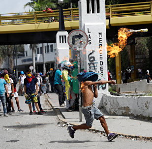 A demonstrator throws a molotov cocktail during clashes with security forces at a rally against Venezuelan President Nicolas Maduro's government in Caracas, Venezuela July 10, 2017