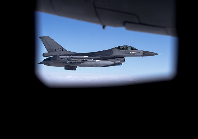 A Royal Netherlands Air Force F- 16 fighter jet participating in NATO's Baltic Air Policing Mission operates in Lithuanian airspace during a Ramstein Alloy air force exercise, April 25, 2017