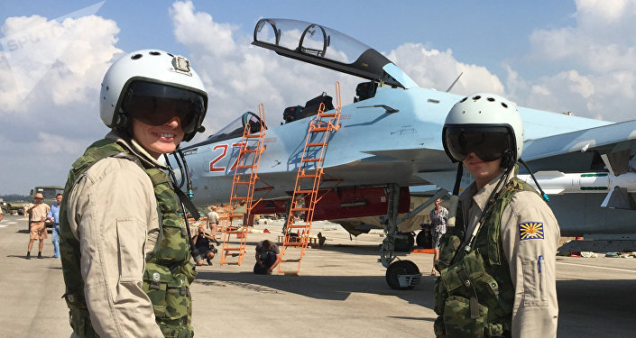 Russian pilots prepared to board the SU-30 attack plane to take off from the Hmeymim aerodrome in Syria.