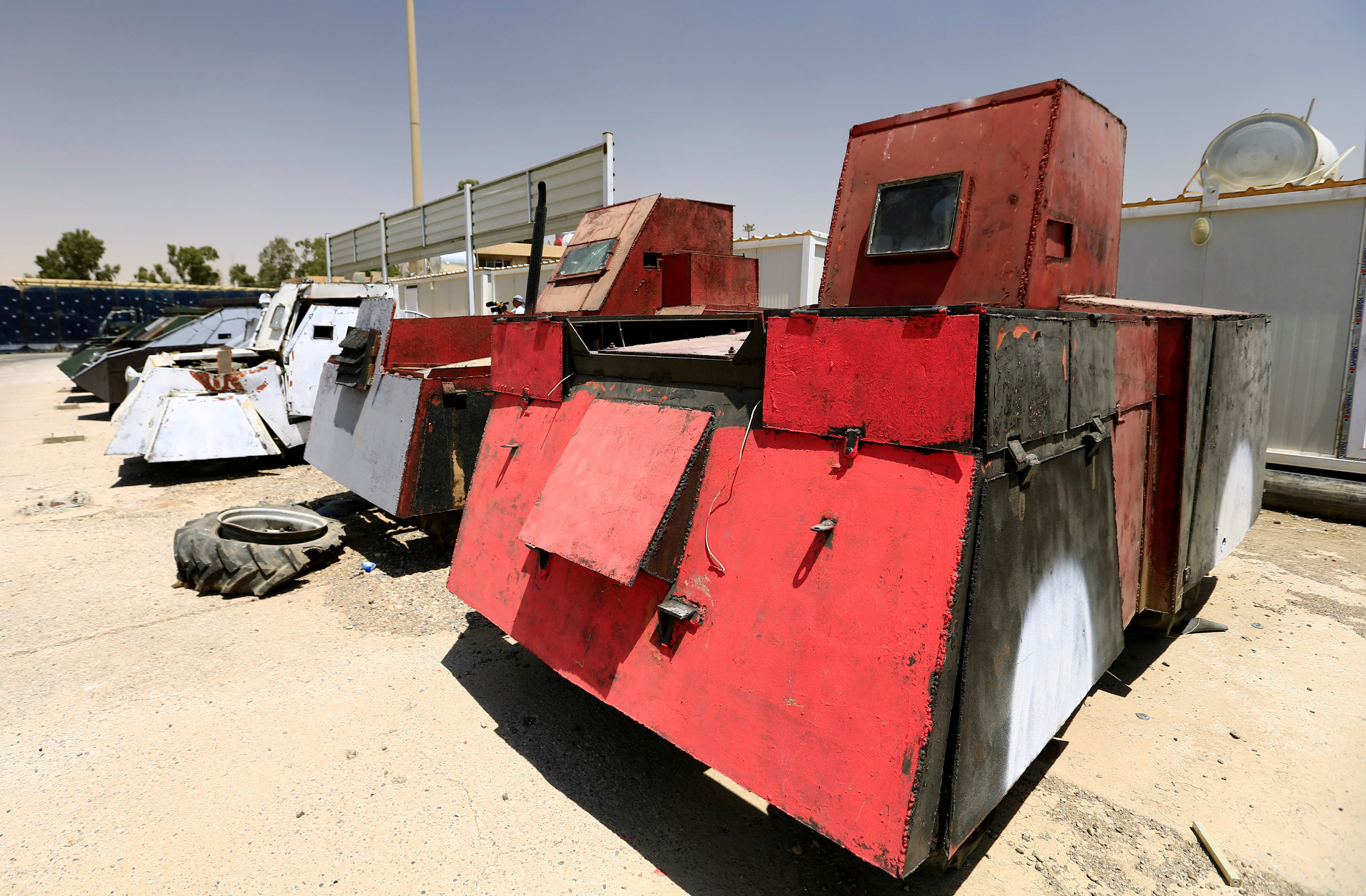 Vehicles used for suicide car bombings, made by Islamic State militants, are seen at Federal Police Headquarters after being confiscated in Mosul, Iraq July 13, 2017