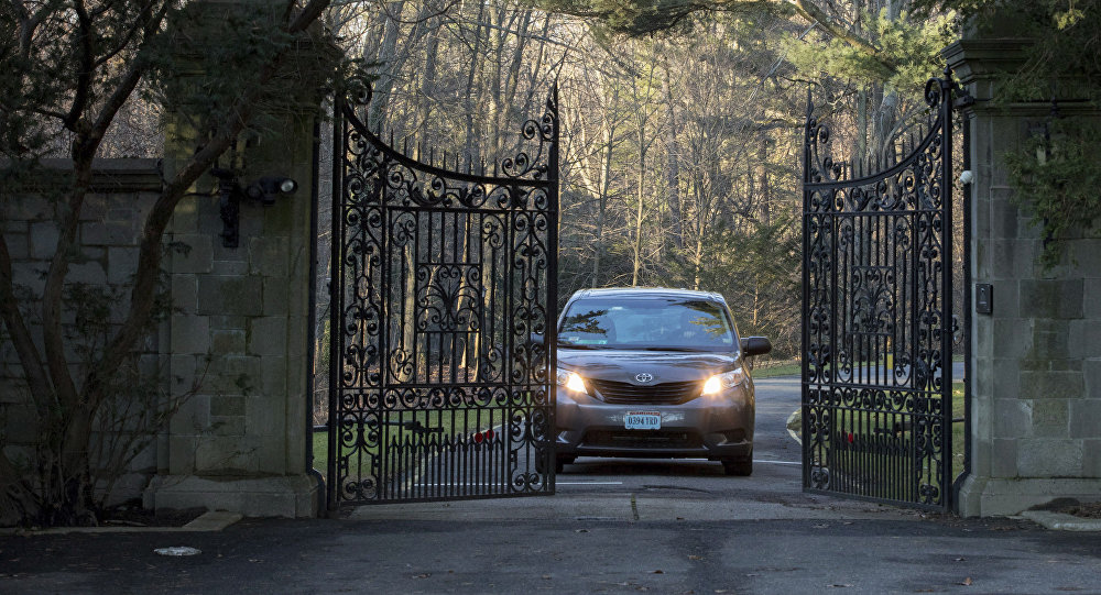 A car with diplomatic license plates drives out of a compound near Glen Cove, N.Y., on Long Island on Friday, Dec. 30, 2016. Russia maintains this and another weekend retreat for its United Nations diplomats about an hour's drive outside New York City — each in one of Long Island's old Gold Coast mansions. U.S. officials didn't clarify which of the two countryside compounds would be closed