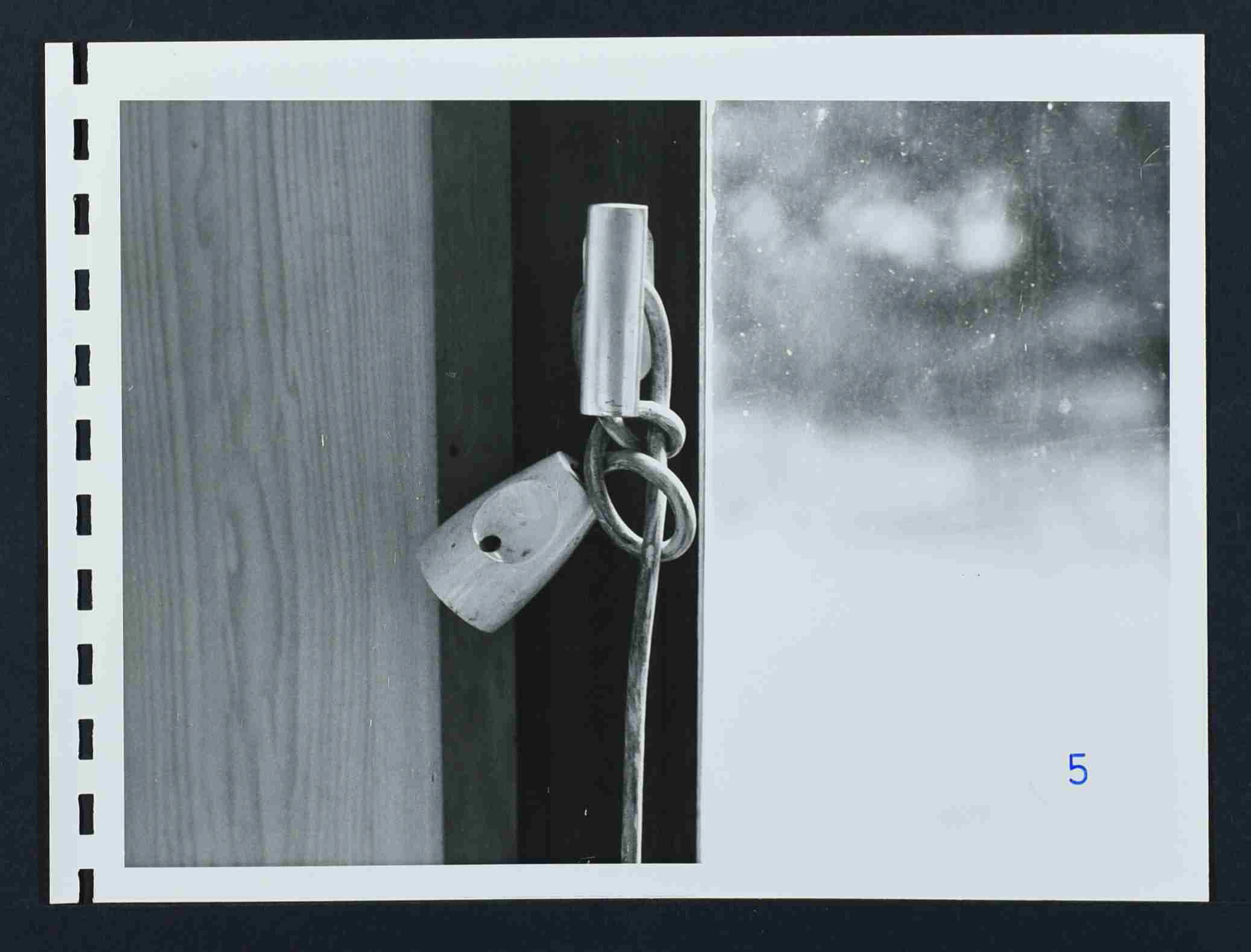 Photo of the electric extension cable tied to the window of the cabin where Hess was found strangled.
