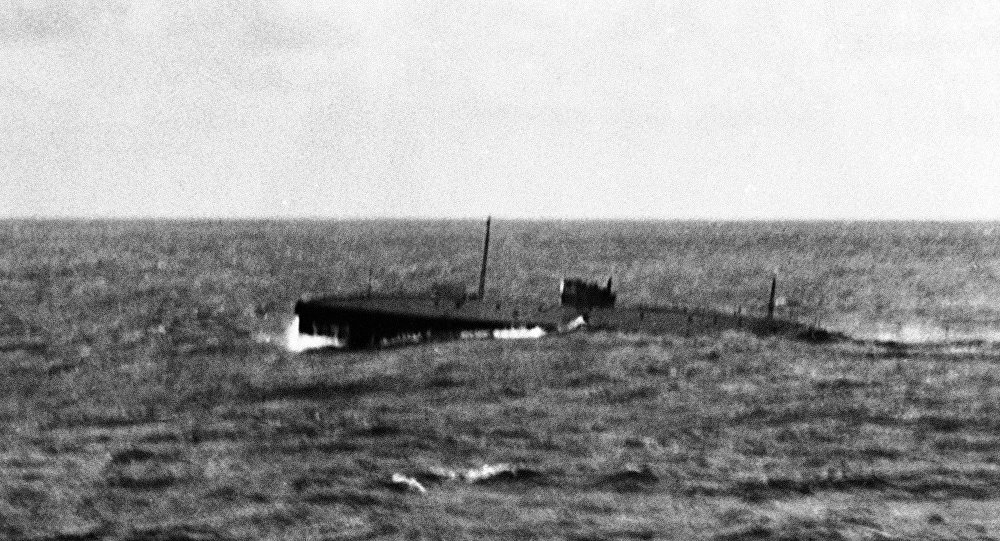 The submarine Nautilus in the Mid Atlantic Ocean, photographed during bad weather from the White Star Motor Liner named Britannic in 1931. The submarine was towed into Queenstown by the US Battleship Wyoming around June 16, 1931.