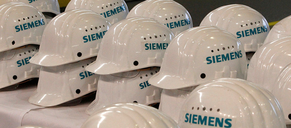 Saftey helmets are piled up for media representatives at the Siemens AG gas turbine factory hall in Berlin, Germany, November 8, 2012.