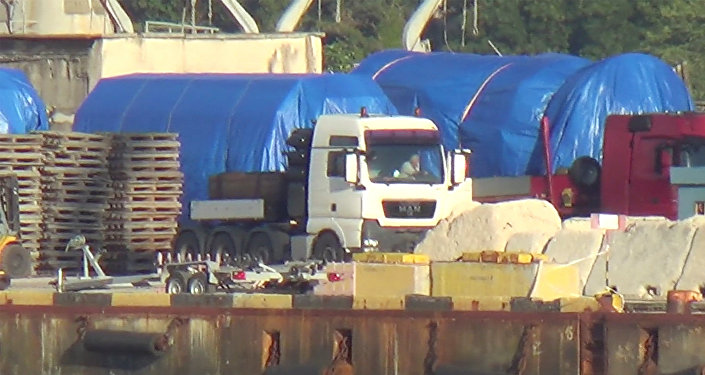 A still image taken from a video footage shows blue tarpaulins covering equipment at the port of Feodosia, Crimea July 11, 2017. Video footage taken July 11, 2017.