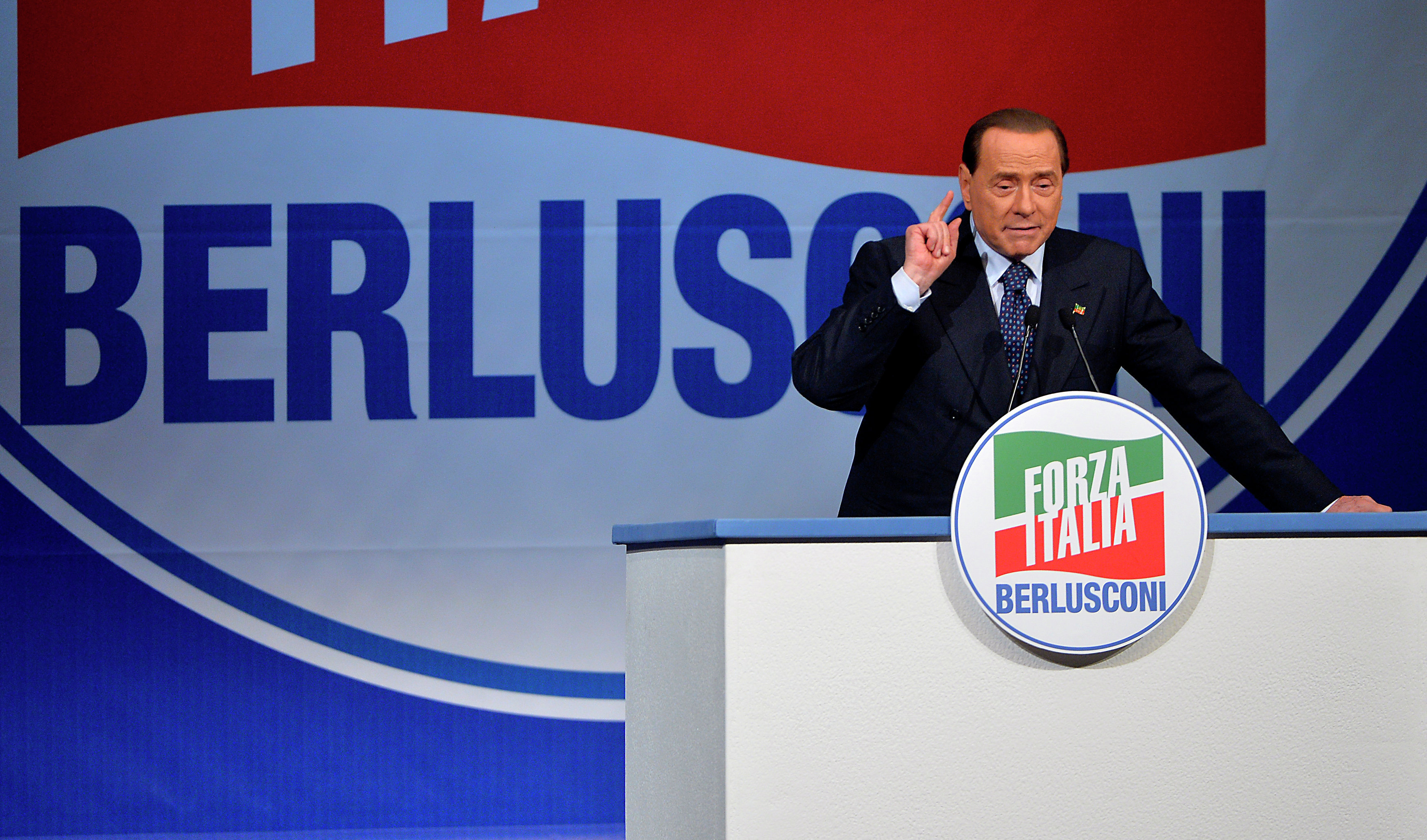 Former Italian Prime Minister and president of the Italian center-right Forza Italia (FI) party, Silvio Berlusconi gives a speech on May 22, 2014 in Rome