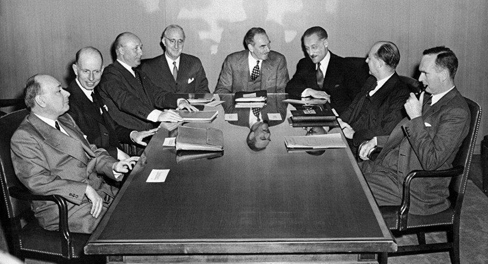 Negotiators of the North atlantic treaty country members talk together after finishing the draft of the treaty 18 march 1949 in Washington. The North Atlantic treaty was signed 04 April 1949 during an official ceremony in Washington creating the North Atlantic Treaty Organization (NATO).