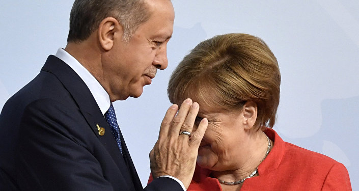 German Chancellor Angela Merkel, right, greets Turkey's President Recep Tayyip Erdogan at the beginning of the G-20 meeting in Hamburg, northern Germany, on Friday, July 7, 2017