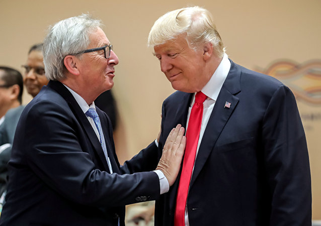 U.S. President Donald Trump, right, talks with European Commission President Jean-Claude Juncker, left, prior to a working session at the G-20 summit in Hamburg, Germany, July 8, 2017