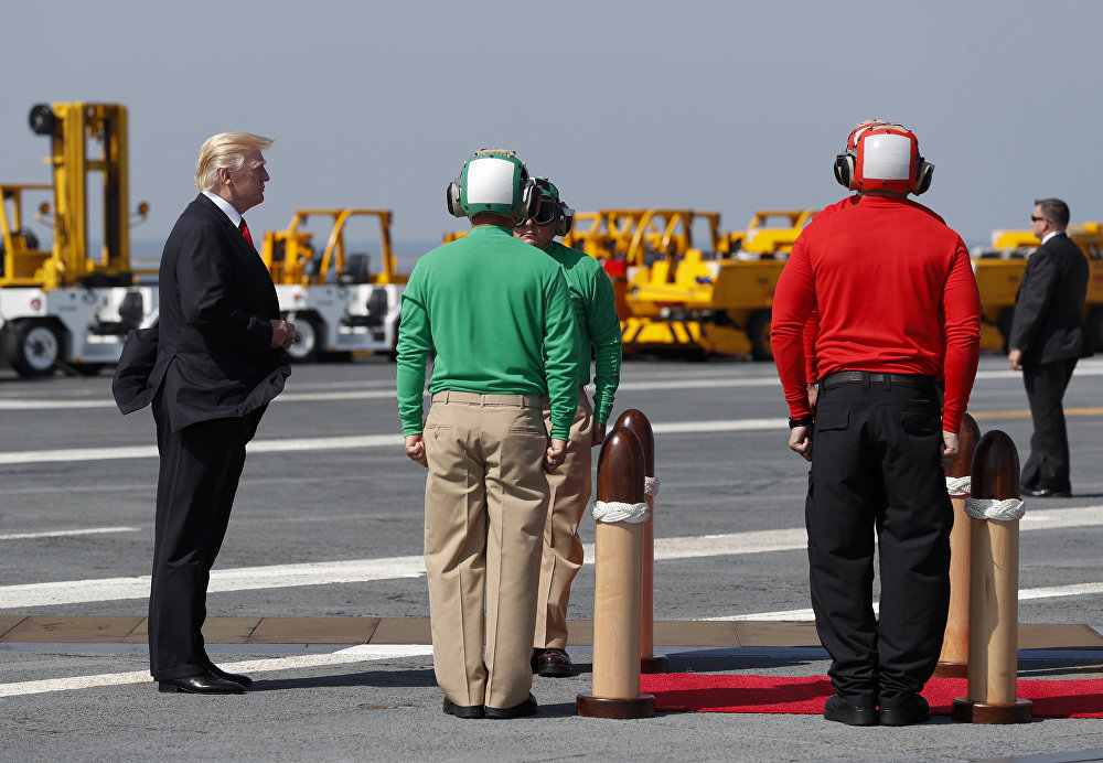 President Donald Trump pauses on the flight deck as he arrives for the commissioning ceremony of the aircraft carrier USS Gerald R. Ford (CVN 78) at Naval Station Norfolk, Va., Saturday, July, 22, 2017.