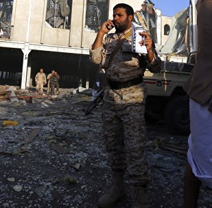 People inspect the aftermath of a Saudi-led coalition airstrike in Sanaa, Yemen, Saturday, Oct. 8, 2016.
