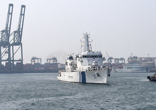Indian Coast Guard Ship (ICGS) Shaunak a new offshore patrol vessel (L) is escorted by a tug as she arrives at port in Chennai on March 19, 2017, making her maiden visit after commissioning into the coastguard eastern fleet in Goa