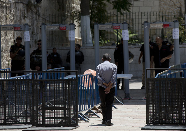 A Palestinian man walks towards a metal detector at the Al Aqsa Mosque compound in Jerusalem's Old City, Wednesday, July 19, 2017