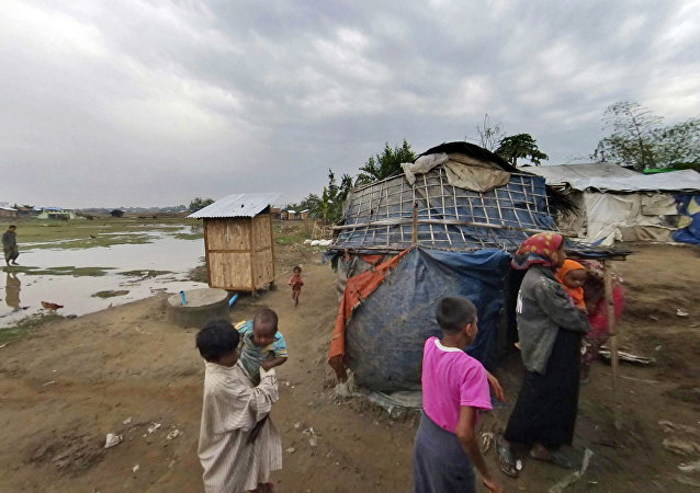 In this Friday, March 17, 2017, image made from video, people who identify themselves as Rohingya, walk at the Dar Paing camp, north of Sittwe, Rakhine state, Myanmar. More than 120,000 Rohingya were forced into camps five years ago, and their suffering may have only worsened since Nobel Peace laureate Aung San Suu Kyi rose to power in Myanmar last year.