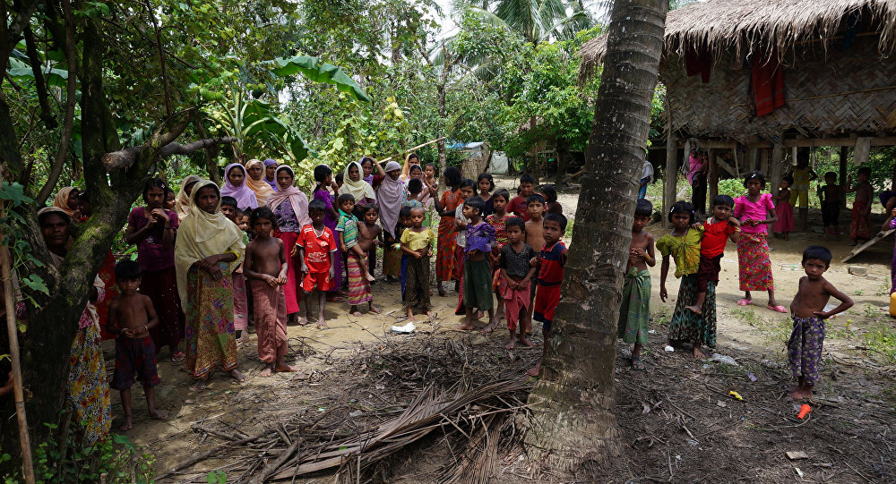 Rohingya villagers watch as international media visit Maung Hna Ma village, Buthidaung township, northern Rakhine state, Myanmar July 14, 2017.