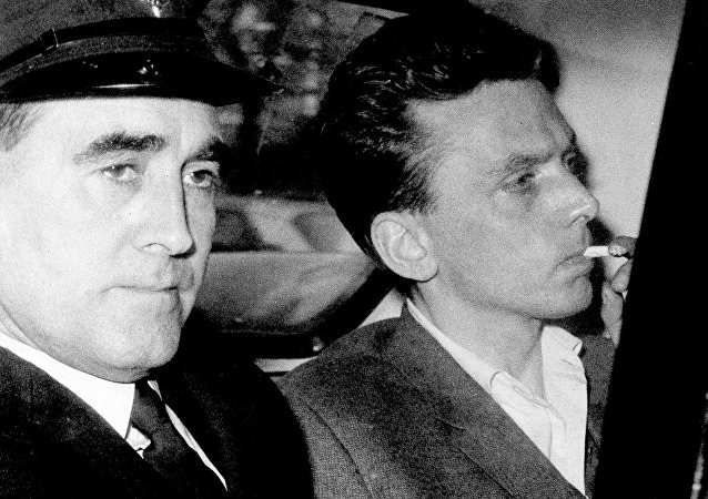 In this file photo dated Oct. 1965, Ian Brady, right, is escorted as he arrives at the courthouse in Hyde, Cheshire, England, to be convicted of the Moors murders of five children together with accomplice Myra Hindley in the Greater Manchester area of England.