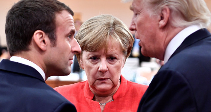 French President Emmanuel Macron, German Chancellor Angela Merkel and US President Donald Trump confer at the start of the first working session of the G20 meeting in Hamburg, Germany, July 7, 2017.