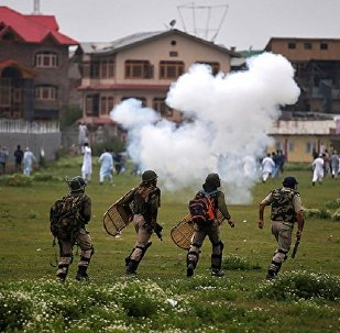 Indian police chase the demonstrators during a protest after Eid al-Fitr prayers, in Srinagar June, 26, 2017