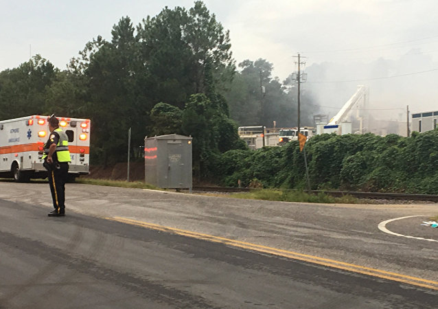 Emergency personnel respond to the scene of fire at a plant that produces agricultural chemicals on Saturday, July 29, 2017 in Atmore, Ala