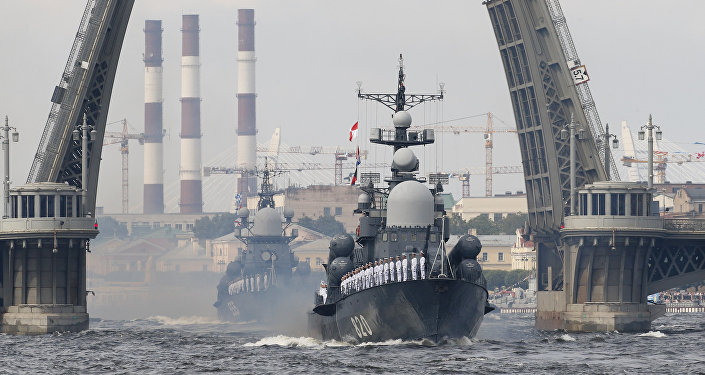 A Russian Navy vessels ride along Neva river taking part in the naval parade during the Navy Day celebration in St.Petersburg, Russia, on Sunday, July 30, 2017