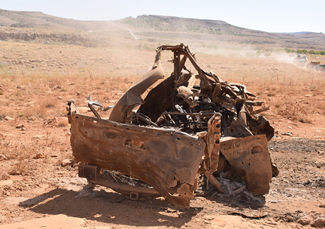 A destroyed vehicle in Aarsal