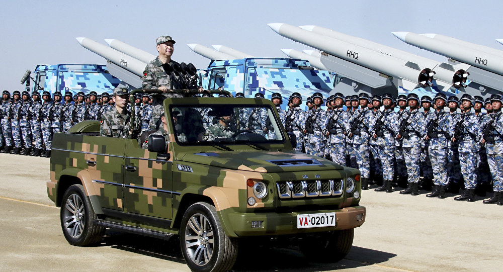 In this photo released by Xinhua News Agency, Chinese President Xi Jinping stands on a military jeep as he inspects troops of the People's Liberation Army during a military parade to commemorate the 90th anniversary of the founding of the PLA at Zhurihe training base in north China's Inner Mongolia Autonomous Region, Sunday, July 30, 2017