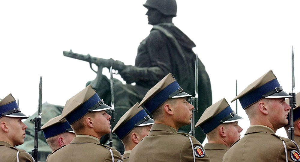 Polish Army soldiers stand to attention during a wreath laying ceremony marking the 62nd anniversary of the end of WWII in Europe, at the Soviet Army cemetery in Warsaw, Poland, Wednesday, May 9, 2007